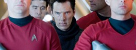 Benedict Cumberbatch guarded by *not enough* red shirts.