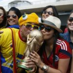 Colombian national soccer team fans kiss a mock World Cup trophy during their team's training session at Estadio Mineirao in Belo Horizonte, Brazil, 13 June 2014