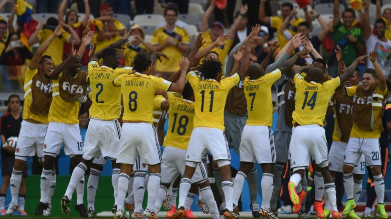 Colombian players celebrate after Colombia's defender Pablo Armero