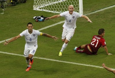 Dempsey, sporting crooked nose and bruise, scores against Portugal