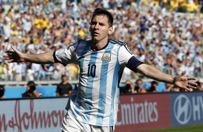 Messi celebrates after scoring against Iran