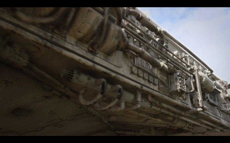 Side view of the Millenium Falcon as the camera pans towards the front