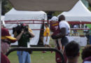 Moses carries kid onto the training field #SkinsCamp Redskins Training Camp 2015